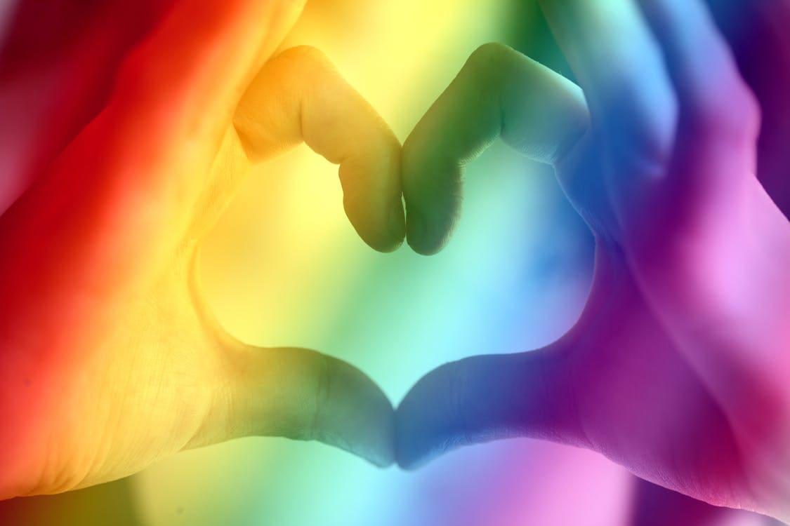 Queer hands forming heart